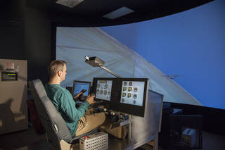 X-57 principal investigator Sean Clarke flies the X-57 simulator.