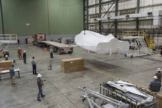 Sierra Nevada Corporation's space vehicle suspends in a hangar at NASA's Armstrong to undergo testing.