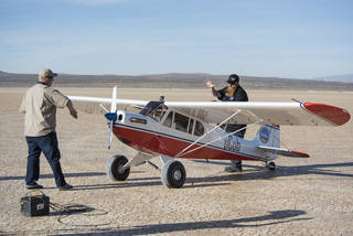 Crew members perform a series of preflight system checks on the MicroCub.