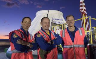 NASA astronauts Nicole Mann, left, Mike Fincke, and Boeing astronaut Chris Ferguson, right
