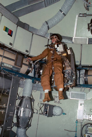 Astronaut Alan L. Bean, Skylab 3 commander, flies the M509 Astronaut Maneuvering Equipment in the forward dome area of the Orbit