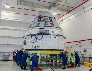 The Boeing CST-100 Starliner spacecraft to be flown on Orbital Flight Test-2 (OFT-2) is seen in the Commercial Crew and Cargo Processing Facility at NASA's Kennedy Space Center in Florida on June 2, 2021.