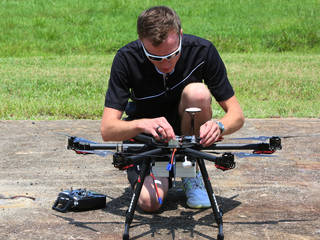 A pilot goes through a checklist before flying an unmanned aircraft system at NASA Langley.