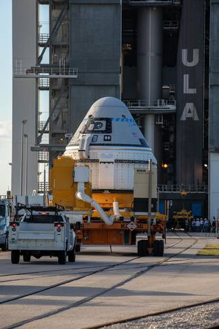 The Boeing CST-100 Starliner spacecraft arrives at the Vertical Integration Facility at Space Launch Complex 41.