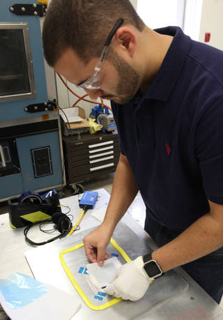 Layers of a structure for a new battery prototype are being prepared in the Prototype Laboratory at NASA's Kennedy Space Center.