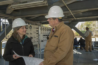 Tara Marshall, left, talks about the installation of a pressurization control panel at Test Stand 4693 with Mike Nichols.