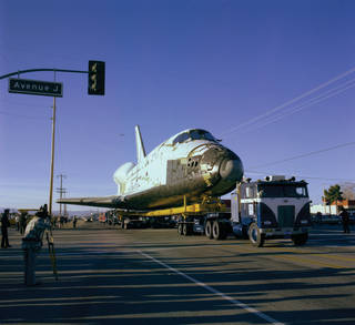 Space Shuttle Columbia makes the overland travel from the Rockwell International in Palmdale to Edwards.