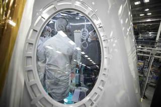 Engineers work inside the ECLSS Module