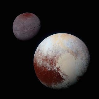 Close-up view of Pluto shows the dwarf planet has a light-colored patch shaped like a heart. Charon is shown behind Pluto.
