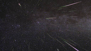 An outburst of Perseid meteors lights up the sky in August 2009 in this time-lapse image.