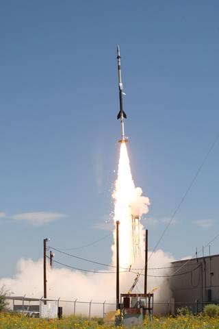 HERSCHEL sounding rocket launch; slender rocket taking flight against a blue-sky background