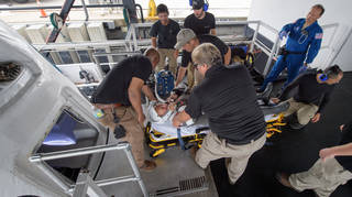 NASA astronaut Doug Hurley, along with teams from NASA and SpaceX, rehearse crew extraction from SpaceX's Crew Dragon