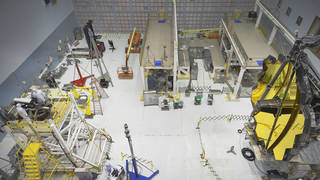 """Engineers conduct a """"Center of Curvature"""" test on NASA's James Webb Space Telescope in the clean room."""