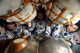 Expedition 45 crew members in the Soyuz TMA-17M