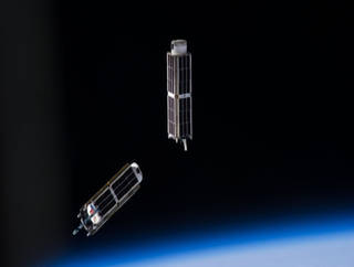 Image of two smallsats in orbit
