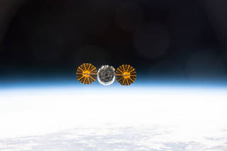image of Cygnus spacecraft in orbit over the earth