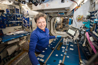 NASA astronaut Peggy Whitson performing the Genes in Space-3 investigation