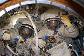 Cosmonauts Alexander Misurkin (left) and Anton Shkaplerov in their Russian spacesuits before a Feb.2 spacewalk outside ISS