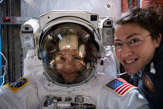 astronauts Christina Koch and Jessica Meir prepping for space walk