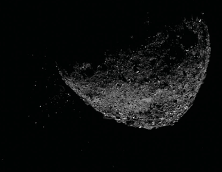 asteroid on black with particles