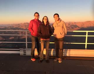 three astronomers at Magellan II telescope in Chile