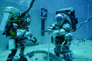 Teams are evaluating how to train for lunar surface operations during Artemis missions, in the Neutral Buoyancy Lab at Johnson S