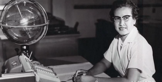 NASA research mathematician Katherine Johnson is photographed at her desk at Langley Research Center in Hampton