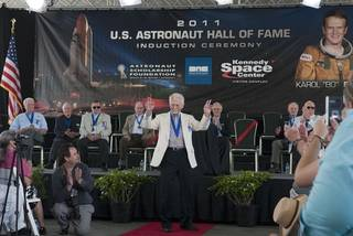 Hall of Fame astronaut Owen Garriott thanks the audience for their applause at the 2011 U.S. Astronaut Hall of Fame induction