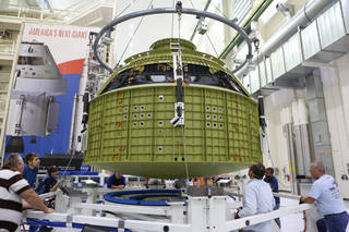 A Crane Lowers the Orion Crew Module Structural Test Article