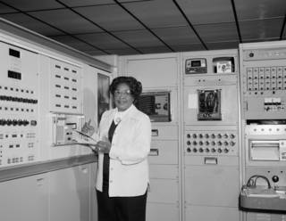 Black and white photo of Mary Jackson in front of computers