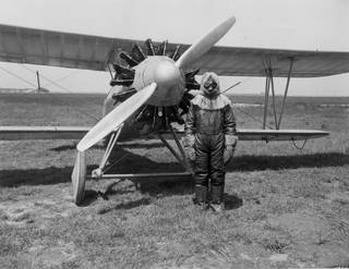NACA test pilot prepares to fly an Apache biplane to high altitude