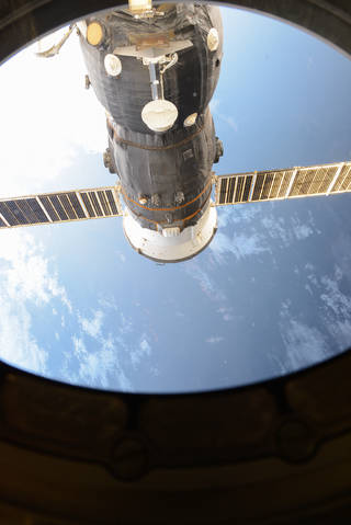 The unpiloted ISS Progress 62 Russian cargo ship is seen docked to the Pirs docking compartment of the International Space Stati