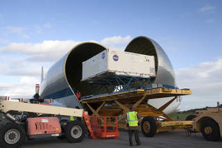The Orion heat shield is offloaded from NASA's Super Guppy aircraft at the Shuttle Landing Facility at Kennedy Space Center.