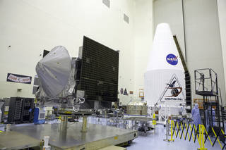 Inside the Payload Hazardous Servicing Facility at NASA's Kennedy Space Center in Florida, the agency's OSIRIS-REx spacecraft is