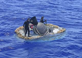 Two members of the U.S. Navy's Mobile Diving Salvage Unit (MDSU) 1 Explosive Ordnance Detachment