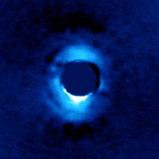 Dusty disk of planetary material surrounding the young star HD 141569