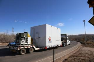 A truck carrying NASA's InSight spacecraft leaves Lockheed Martin Space, Denver