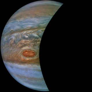 "A ""brown barge"" in Jupiter's South Equatorial Belt is captured in this color-enhanced image from NASA's Juno spacecraft."