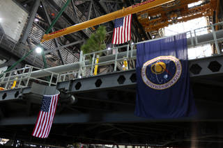 The American flag is in view on the final work platform, A north, as it the platform is lifted for installation in the VAB.