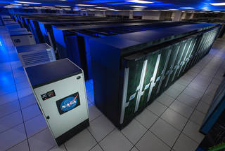 Photo of rows of computer racks that make up the Pleiades supercomputer