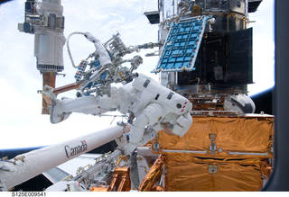 astronauts working on Hubble