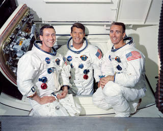 Portrait of three Apollo 7 astronauts in spacesuits