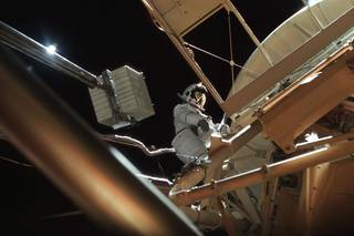 Astronaut Owen Garriott participates in EVA to deploy twin pole solar shield