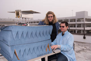 Research scientist Dr. Rebecca Bishop, left, and design engineer Steve Bielat of The Aerospace Corporation