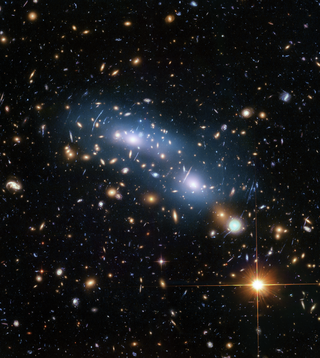 Hubble image of galaxy cluster MACS J0416 showing a starry sky scene with central blue smear