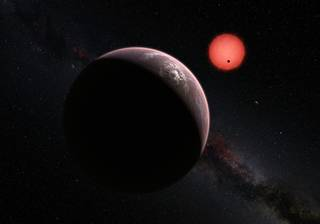 Artist's impression, planets discovered by TRAPPIST orbiting a red dwarf star about 40 light years from Earth (NASA/JPL)
