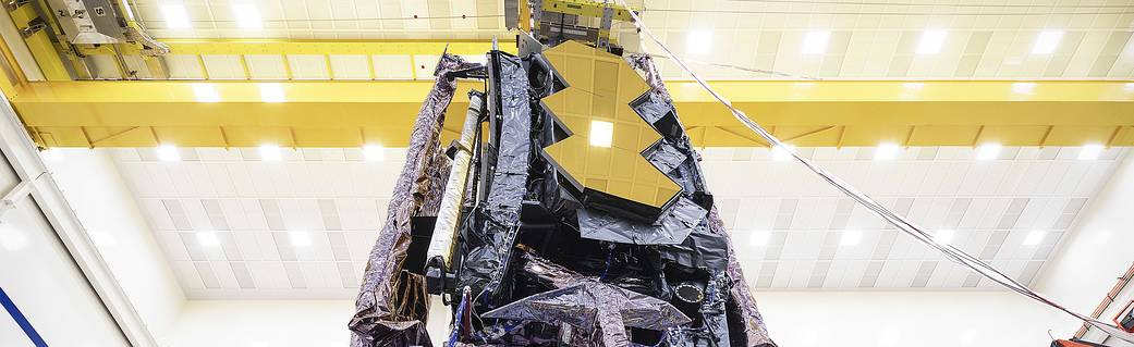 Technicians prepare the James Webb Space Telescope for transport to nearby testing facilities.