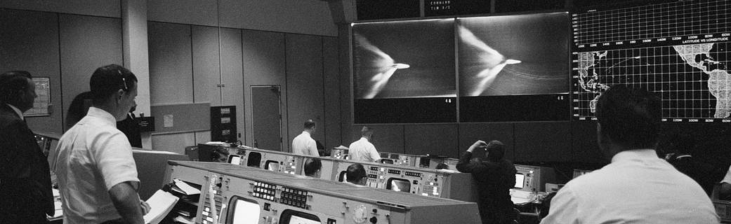 Flight controllers watch a replay of the launch in Mission Control in Houston.