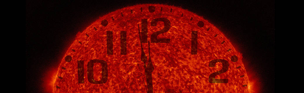 SDO image of sun with clock face superimposed