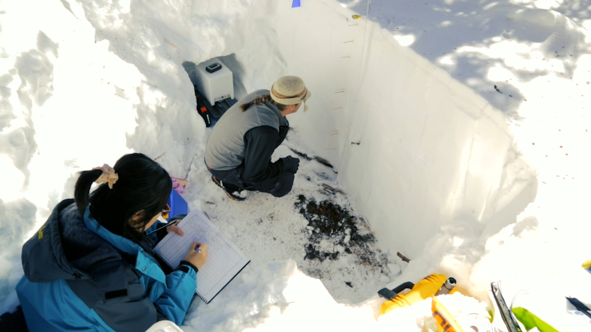Researchers with SnowEx field campaign dug snow pits to determine snow water equivalent on the ground to compare with estimates made from airborne sensors flying overhead.